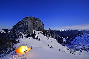 Illuminated tent in front of mount Risserkogel, Plankenstein in background, Bavarian Prealps, Upper Bavaria, Germany