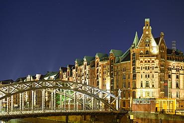 Illuminated bridge Brooksbruecke with Warehouse district in the background, Warehouse district, Speicherstadt, Hamburg, Germany