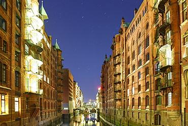 Illuminated buildings of warehouse district, Warehouse district, Speicherstadt, Hamburg, Germany