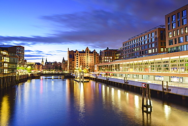 Illuminated port Magdeburger Hafen with warehouse district in the background, Hafencity, Hamburg, Germany