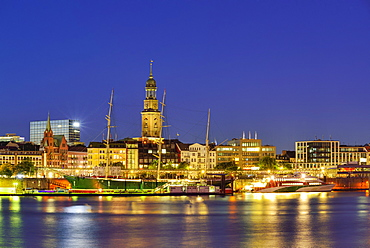 River Elbe with museum ship Rickmer Rickmers and church St. Michaelis, Michel, in the background, at night, Hamburg, Germany