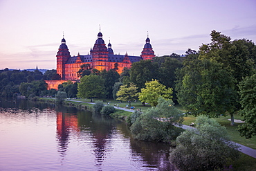 Johannisburg Palace and parklands along the Main river at dusk, Aschaffenburg, Franconia, Bavaria, Germany