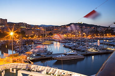 Bow of cruise ship MS Deutschland (Reederei Peter Deilmann) and sailing boats in the marina at dusk, Palma, Mallorca, Balearic I