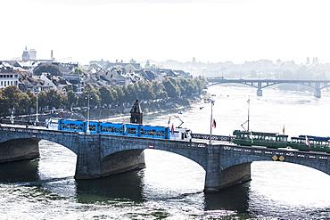 Trams passig Mittlere Bruecke, Basel, Basel-Stadt, Switzerland