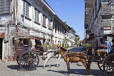 Horse drawn carriages in the historical city of Vigan City, UNESCO World Heritage Site, Ilocos Sur province, on the main island