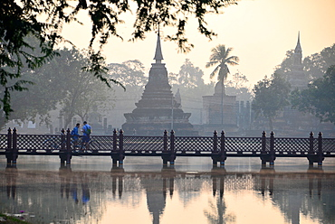 Wat Tranpang Ngoen and reflection in a lake, Old-Sukhothai, Thailand