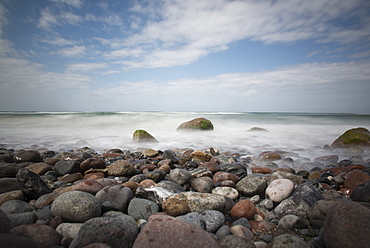 Round polished pebbles on the Baltic Sea beach in the Western Pomerania Lagoon Area National Park, Ahrenshoop, Fischland-Darss-Zingst, Mecklenburg-Western Pomerania, Germany