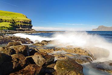 Breakwater at the rocky beach in the bay of Gjogv, Eysturoy Island, Faroe Islands