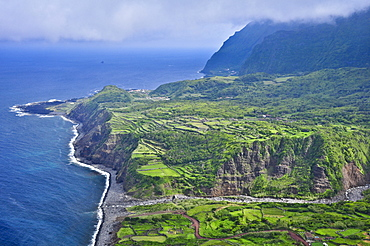 Steep coast with cliffs, terraces and mountains between Faja Grande and Fajazinha, Island of Flores, Azores, Portugal, Europe, Atlantic Ocean