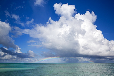 Rainbow above seawater at Meeru Island Resort, Meerufenfushi, North-Male-Atoll, Maldives