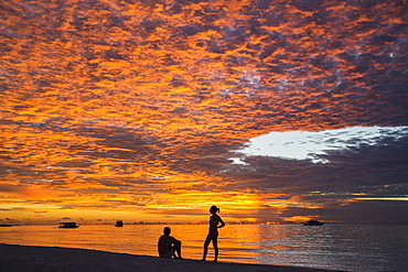 Sunset with two people at Meeru Island Resort, Meerufenfushi, North-Male-Atoll, Maldives