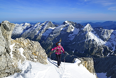 Female back-country skier ascending to Birkkarspitze, Karwendel range, Tyrol, Austria