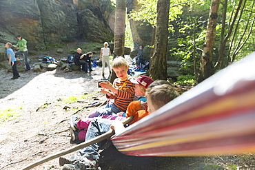 Children waiting in a hammock, climbing area, Saxony Switzerland, Hercules' Pillars, women, Elbe sandstone mountains, Dresden, Saxony, Germany, Europe
