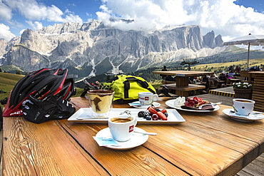 Dessert with espresso at the Emilio Comici hut at Langkofel, behind it Sella group, Trentino South Tyrol, Italy