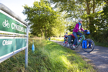 Mother and son on a bicycle tour, Baltic sea, MR, Bornholm, near Olsker, Denmark, Europe