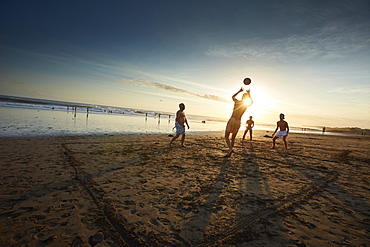 Beachvolley players on the beach of Canggu, Ebbe, Bali, Indonesia