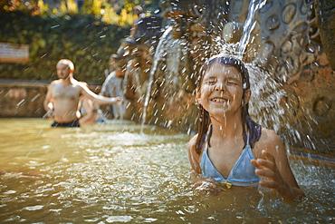 8 year old girl, Hot Springs Air Panas Banjar at Bubunan, Bali, Indonesia