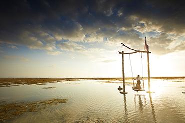 Beach swing at low tide, Gili Trawangan, Lombok, Indonesia