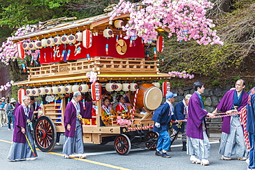 Decorated festival wagon with girls playing music during Yayoi Matsuri in Nikko, Tochigi Prefecture, Japan
