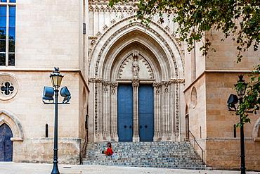Girl in red skirt, stairs of Iglesia Santa Eulalia, historic city centre, Ciutat Antiga, Palma de Mallorca, Majorca, Balearic Islands, Mediterranean Sea, Spain, Europe