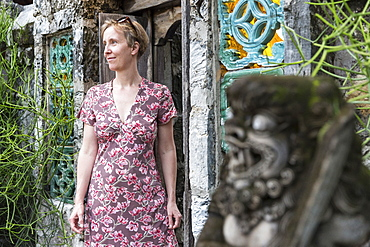 Woman near a door to a hotel, Sanur, Denpasar, Bali, Indonesia