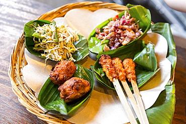 Traditional Balinese food served in banana leaves, Gado-Gado, Sate, Tempe, Ubud, Gianyar, Bali, Indonesia