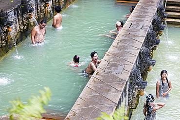 People bathing in hot spring air panas, Banjar Tegeha, Buleleng, Bali, Indonesia