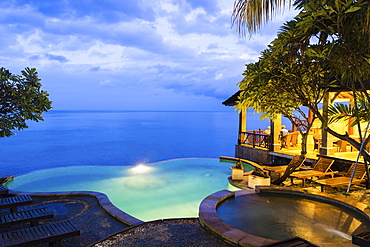 Hotel complex with pool in the evening, Amed, Bali, Indonesia
