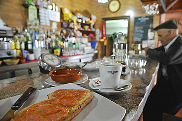 Breakfast with toasted bread and coffee in a bar in Algatocin, Serrania de Ronda, Andalusia, Spain