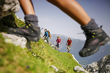 Hikers ascenting, Wetterstein range, Bavaria, Germany