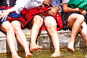 Girls splashing in water, close-up leges, Irsee, Bavaria, Germany