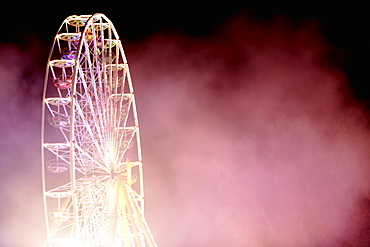 Ferris wheel in the smoke, Kaufbeuren, Bavaria, Germany
