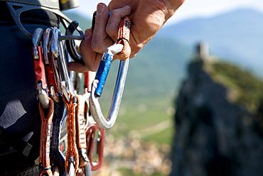 Climber holding carabiner, Arco, Trentino-Alto Adige/Südtirol, Italy