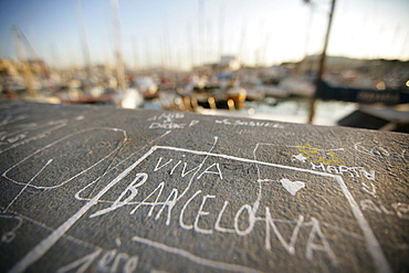 Inscription on the quay wall near the old harbor Port Vell, Barcelona, Katalanien, Spain