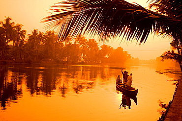 India Kerala backwaters indian people in canoe