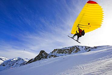 A man with snowboard using a Woopy-Jump, Grimentz, Valais, Switzerland