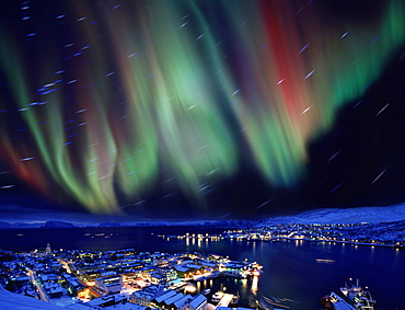 Aurora borealis in Northern Norway, star traces due to earths rotation, Hammerfest, Norway, Europe