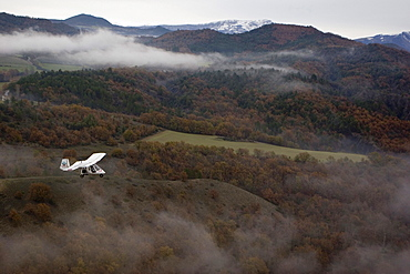 Aerial view of ULM plane above the mountains, South France, Europe