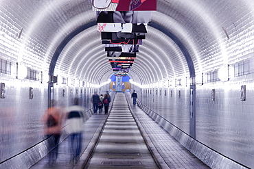Pedestrians in the Old Elbe Tunnel, Hamburg, Germany
