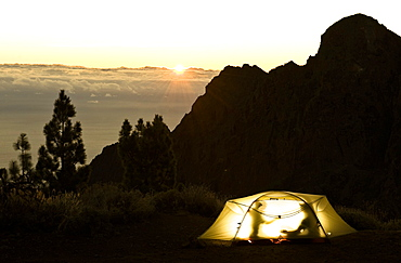 Two silhouettes in a tent in sunset, Teide National Park, Tenerife, Canary Islands, Spain