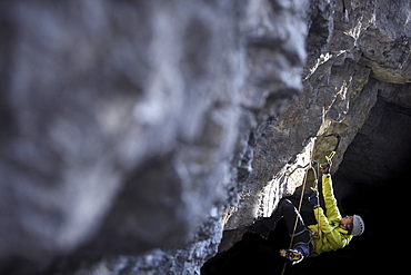 Man climbing in a cave, Immenstadt, Bavaria, Germany