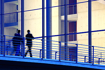 Business people passing pedestrian bridge, Berlin, Germany