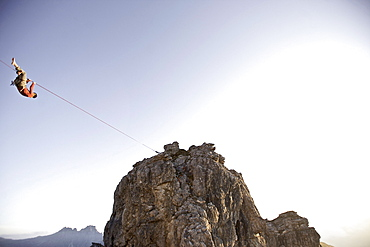 Man hanging on a slackline, Oberstdorf, Bavaria, Germany