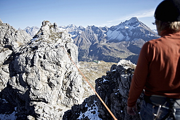 Young man standing in front of a slackline, Oberstdorf, Bavaria, Germany