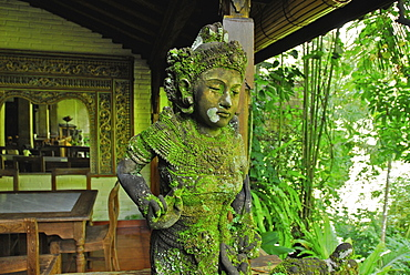 Mossy balinese figure at Murnis Warung, Ubud, Central Bali, Indonesia, Asia