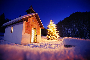 Little chapel with christmas tree at night, Elmau, Bavaria, Germany