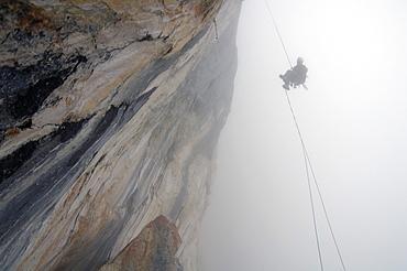 Climber roping in the fog, Tyrol, Austria, Europe