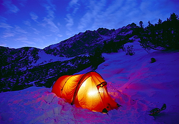 Illuminated tent in the snow in the evening, Karwendel mountains, Bavaria, Germany, Europe