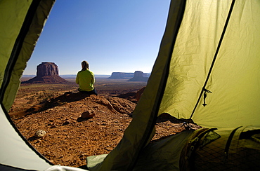 View out of a tent at a sitting woman, Monument Valley, Utah, North America, America