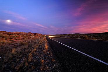 Highway in a barren scenery in the evening, Utah, North America, America